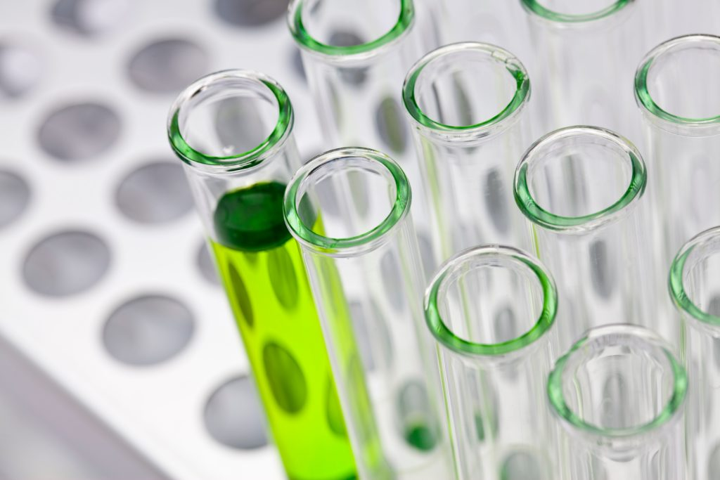 test tube with green liquid