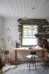 picture of a desk and chair in a shed-like room