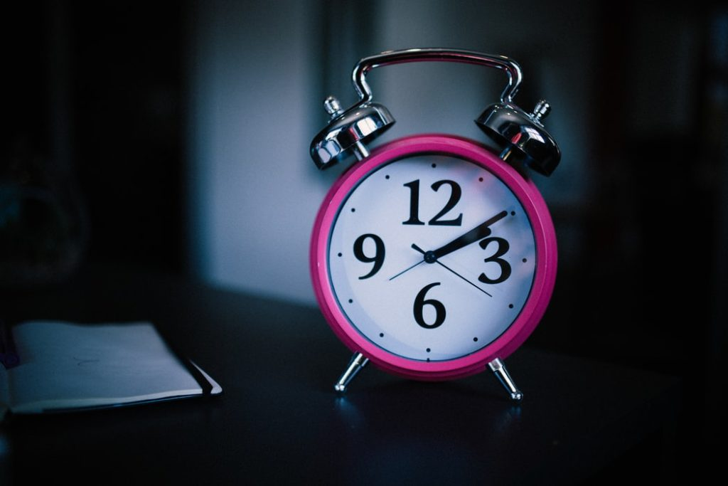 alarm clock on a table in a dark room