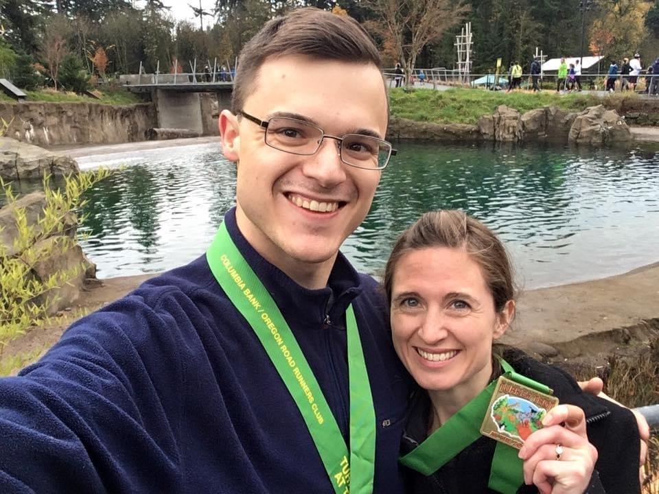 A man and a women with medals around their necks after a Turkey Trot on Thanksgiving
